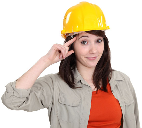 Saluting woman wearing a hard-hat and work attire.